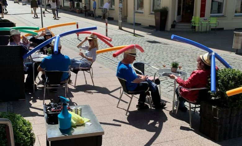 German cafe has customers wear pool noodles to enforce social distancing