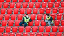 The guards wearing protective masks sat in empty stands at Union Berlin's home stadium, with all Bundesliga matches until the end of the season played behind closed doors.