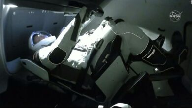 Photo of The hatch opens when astronauts arrive at the International Space Station aboard the SpaceX Crew Dragon