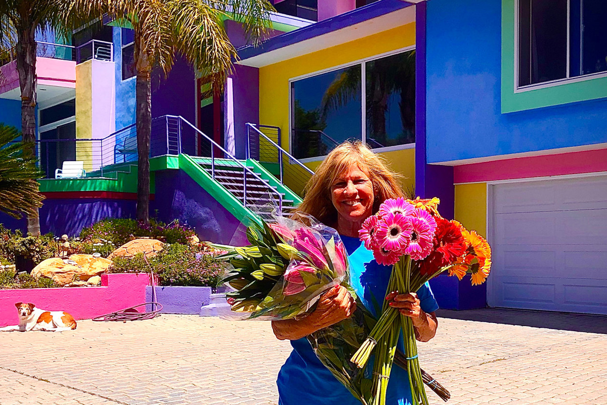 The artist's rainbow house in California brings her excitement but her neighbor is charming