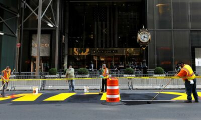 Red paint splashed on Black Lives Matter mural in front of Trump Tower