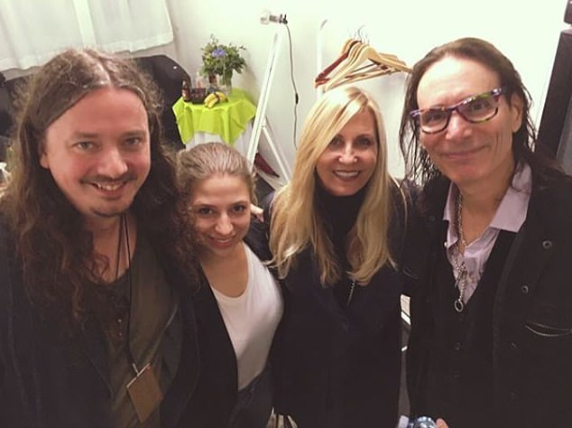 Miss Stasevska with her husband Mr Porra (both left) and legendary rock guitarist Steve Vai (right) who played with Frank Zappa and Whitesnake