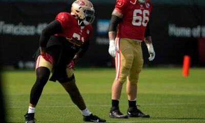 San Francisco 49ers' Trent Williams (left) warms up during NFL training in Santa Clara, California, Tuesday, August 18, 2020.