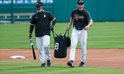 Detroit Tigers third base coaches Ramon Santiago and Alan Trammell drag a sack of ball towards a hill during a training camp at Comerica Park in Detroit, Tuesday July 7, 2020.
