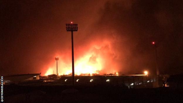 A photo showing the CD Tondola arena burning