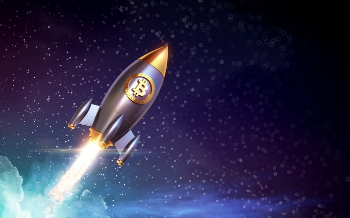 Rocket with bitcoin symbol, shoots into space